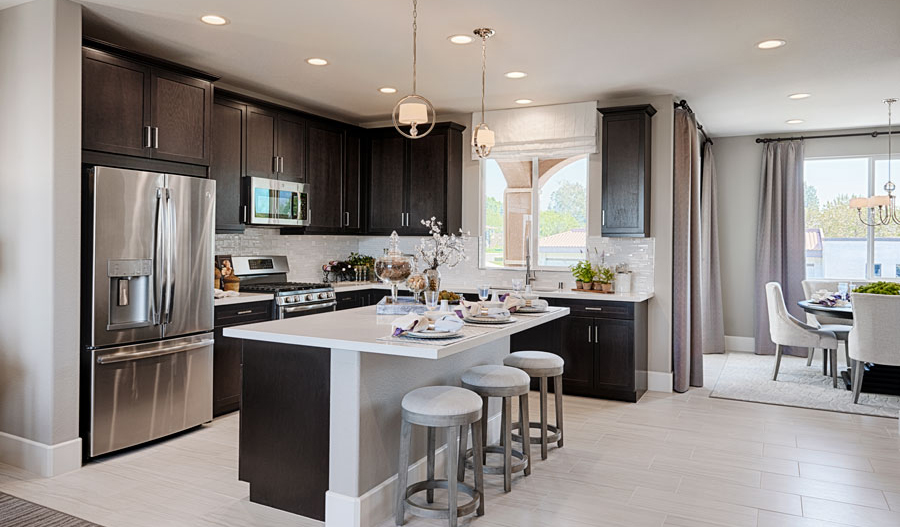 Kitchen with center island in the Evette floor plan