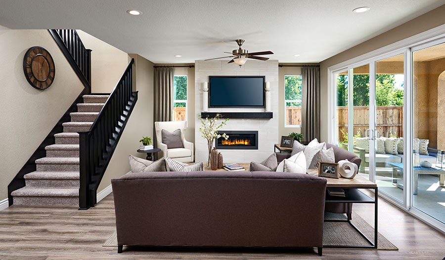 Family room with fireplace in the Andrea floor plan