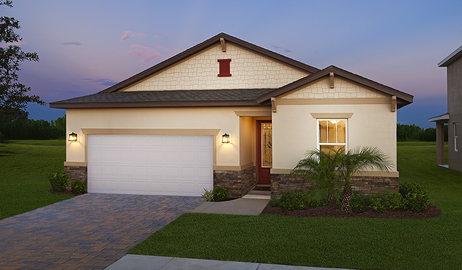 Exterior of the Ruby plan at dusk at The Ridge at Highland Meadows in ORL
