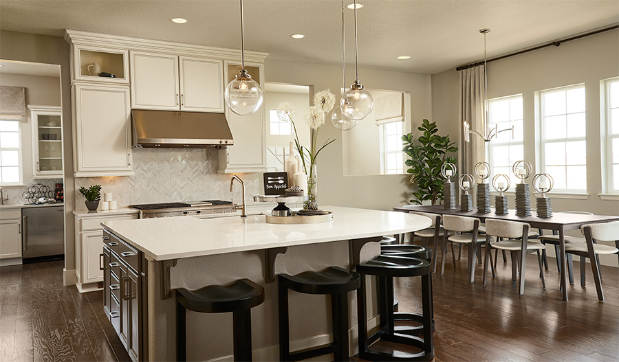 Kitchen and dining room of the Harmon floor plan in Colliers Hill
