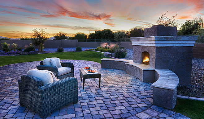 Backyard with fireplace in the Reece floor plan