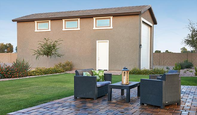 Exterior view of a new home with RV garage. Robert floor plan near Phoenix, Arizona.