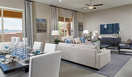 Family room and dining room in the Timothy floor plan
