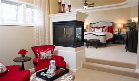 Master bedroom with fireplace in the Vanderbilt floor plan